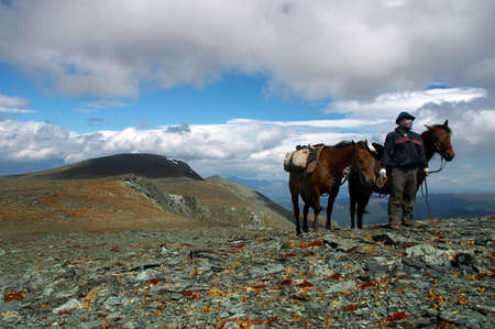 altay: two horses and men in the clouds. Altay