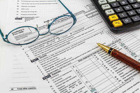 tax law: Filling out tax forms  Stock Photo