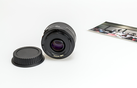 auto focus: 50mm lens on white background with a picture in the background
