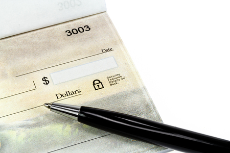 An unwriten check with black pen on a white background