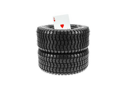 Two new tires and an ace of hearts on white background  photo