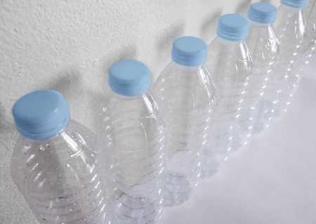 Empty plastic bottles of water for recycle on white background Imagens