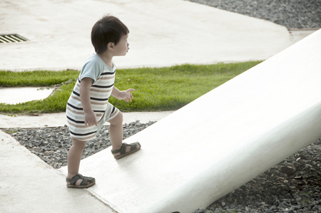 Young boy going up on a slope photo