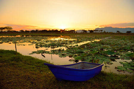 aisa: Blue boat at sunset : Closeup