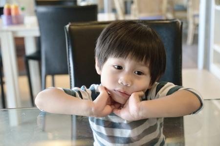 restuarant: Little boy waiting for food in the restuarant