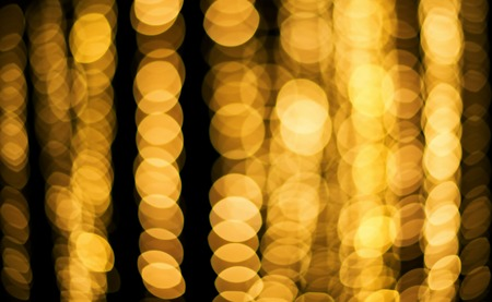 Golden yellow round bokeh defocused light abstract background