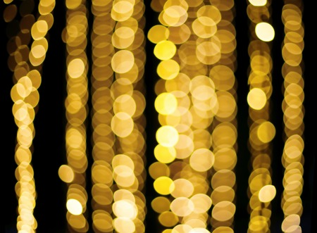 Golden yellow round bokeh line defocused light abstract background Standard-Bild