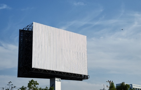 Blank billboard at blue sky background Imagens