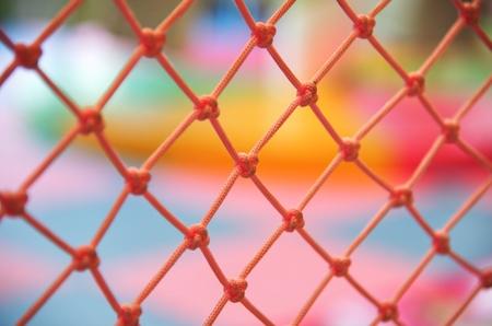 Orange nylon net on colorful background ( playground) : Closeup 스톡 콘텐츠
