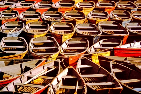 rowboats: Colorful rowboats tied waiting to be rented Stock Photo