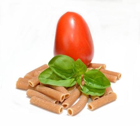 Tomato, basil and whole wheat pasta Stock fotó