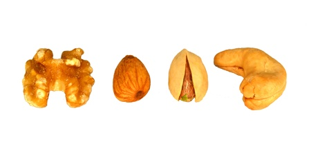Walnut, almond, pistachio and a cashew in a line on a white background. Stock fotó