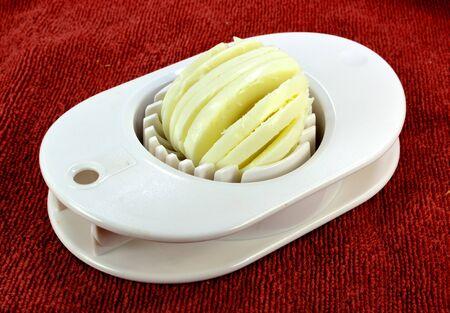 slicer: A hardboiled egg in an egg slicer  Stock Photo