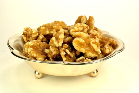 shelled: A small metal dish of shelled walnuts. Stock Photo