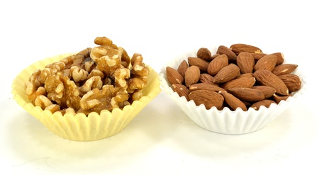 Almonds and walnuts in paper cups  Stok Fotoğraf