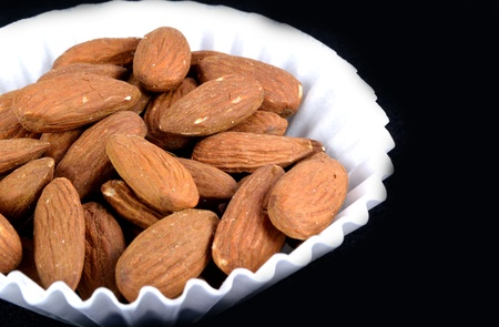 Shelled Almonds in a white paper cup. Stok Fotoğraf