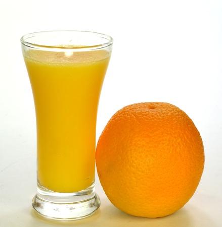 オレンジ ・ ジュースのガラス。