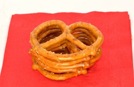 A stack of pretzels on a red napkin.