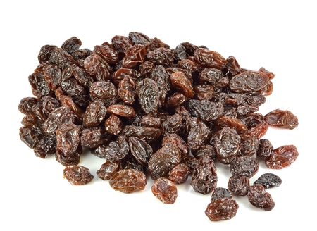 A group of raisins on a white background.