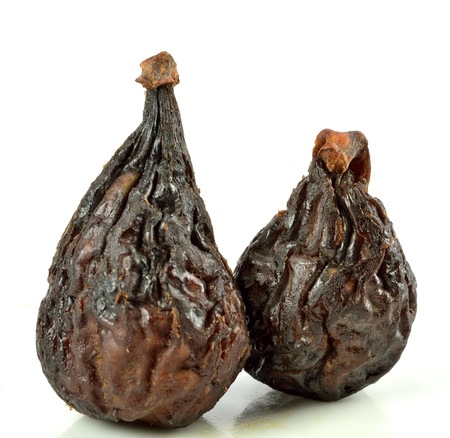 Two figs on a white background. Stock Photo