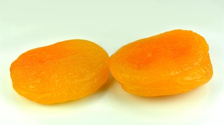 Two dried apricots next to each other.