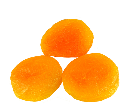 Three apricots on a white background.