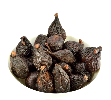 A bowl of figs on a white background. Stock Photo