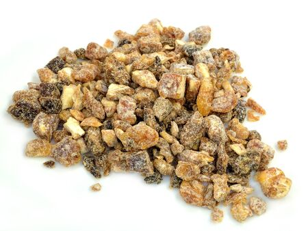 A pile of chopped dates on a white background.