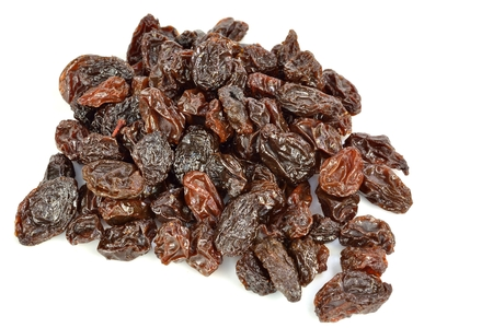 A pile of raisins on a white background.