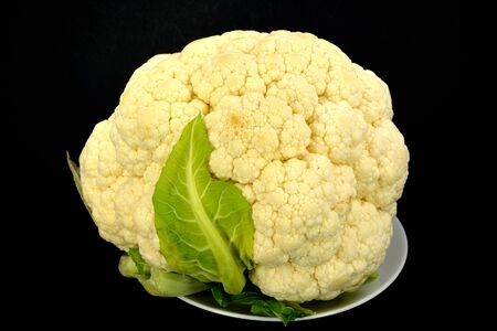 Head of Cauliflower on a black background. Stock Photo