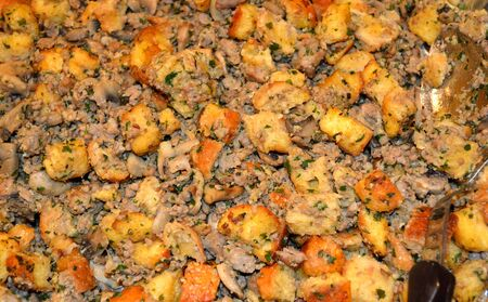Thanksgiving bread and herb stuffing as a texture background.