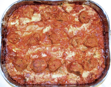 Homemade lasagna with meatballs, fresh out of the oven. Stock fotó