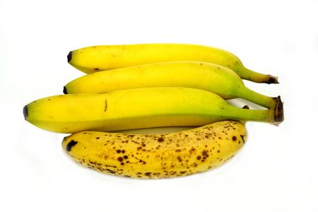Four bananas on a white