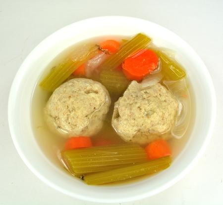 Matzo ball soup on a white background. Stock Photo - 25457183
