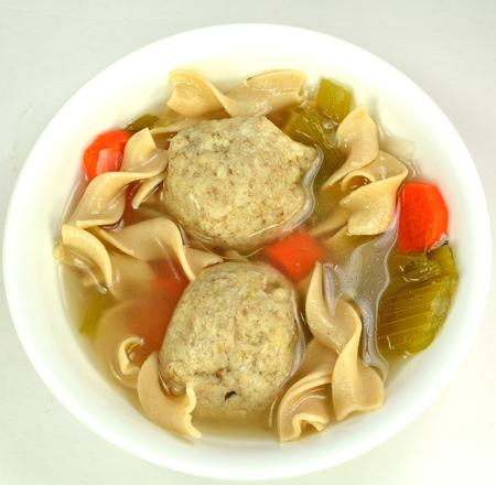 matzah ball: Matzo ball soup on a white .