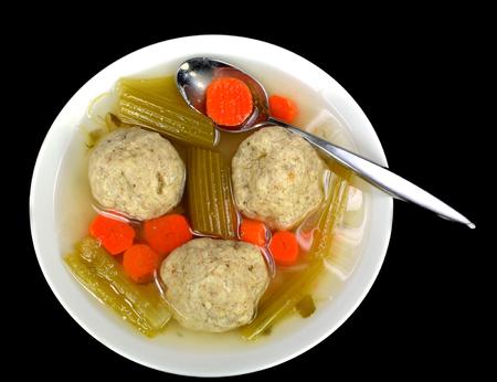 matzah ball: Matzo ball soup on a black background. Stock Photo