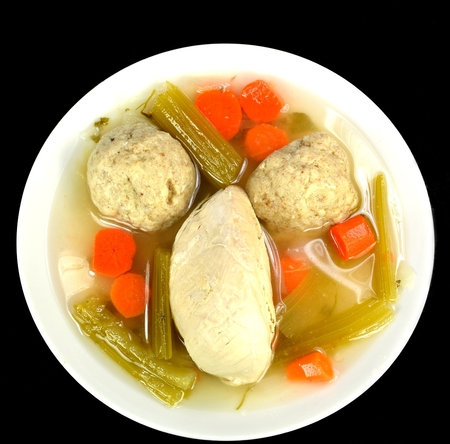 matzo balls: Matzo ball soup with chicken on a white background.