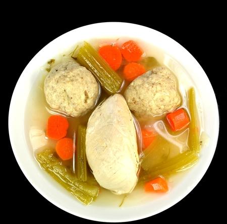 matzo: Matzo ball soup with chicken on a white background.