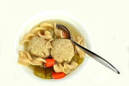 matzoh balls: Matzo ball soup on a white background.