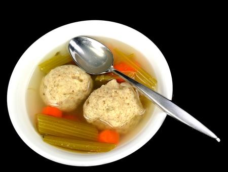Matzo ball soup on a black background. Stock Photo - 25673944