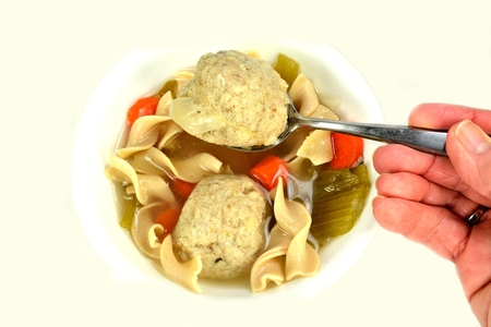 Matzo ball soup on a white background. photo
