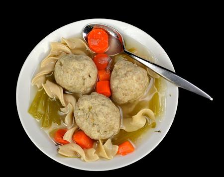 matzoh balls: Matzo ball soup on a black. Stock Photo