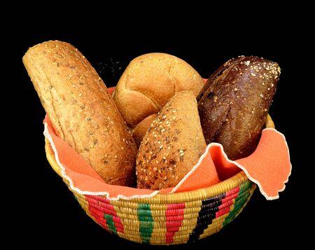Basket of assorted rolls on a black background