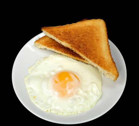 sunnyside: Fried egg with toast on a black background.