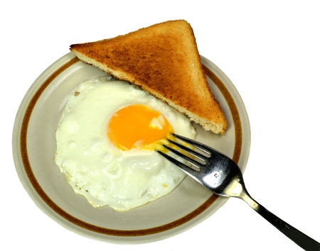sunnyside: Fried egg with toast and a fork. Stock Photo