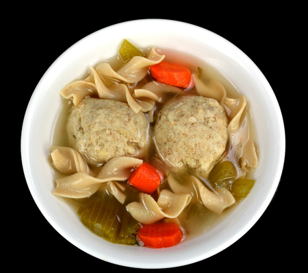 Matzo ball soup on a black background  photo