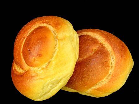 twist: Two egg twist rolls on a black background. Stock Photo