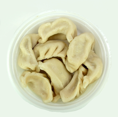 Steamed vegetable dumplings on a white background.