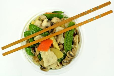 chop sticks: Moo Goo Gai Pan in a bowl with chop sticks.