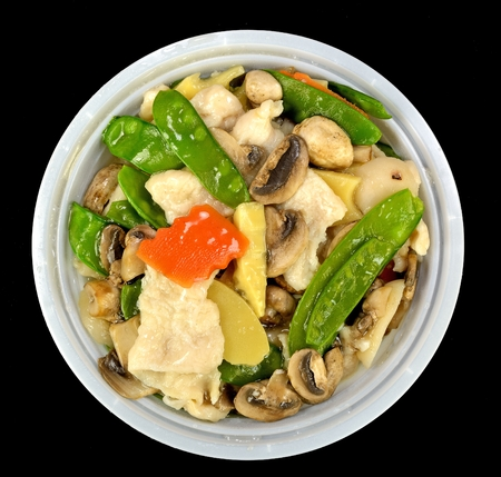 Moo Goo Gai Pan in a bowl on a black background.